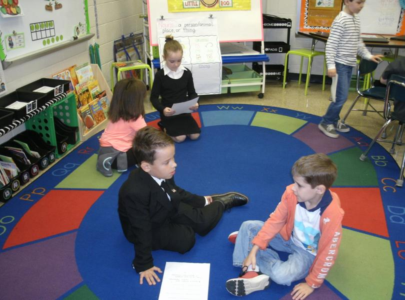 Students share their governmental knowledge with each other.