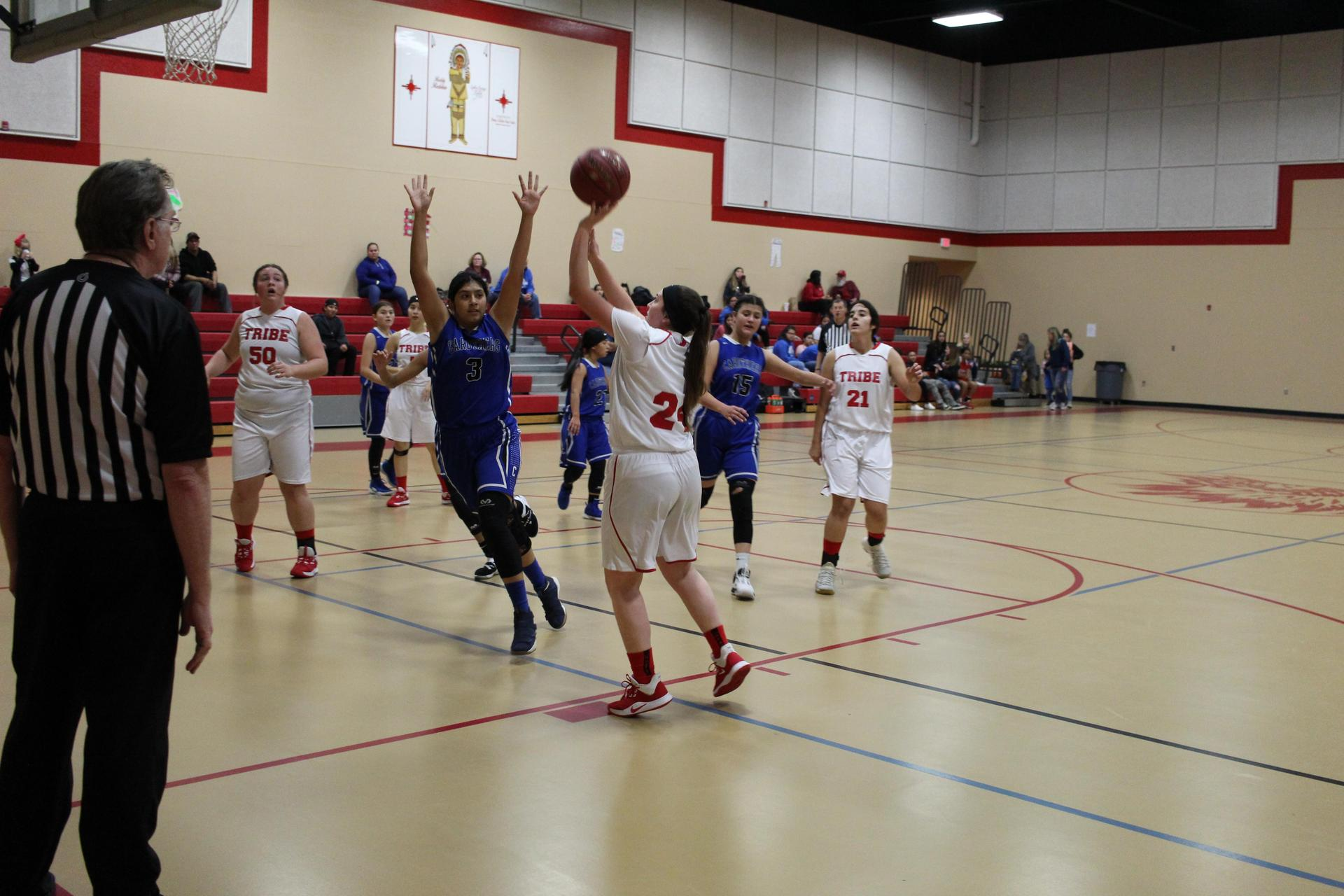 girls playing basketball against Caruthers