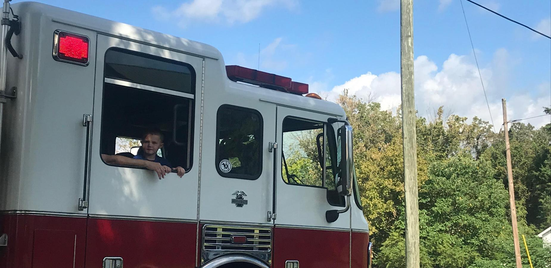 Riding in the firetruck in the parade.