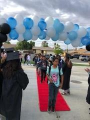 Badger Springs Middle School students walked down a red carpet with cheers from their teachers who wore cap and gown regalia to celebrate College Kick Off.