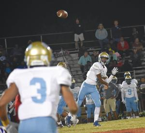 Beddingfield quarterback Garritt Harris releases a pass targeting receiver Jalil Hutcherson on Friday night against North Johnston. The two players connected twice as Harris threw his first touchdown of the season in a 28-7 victory form the Bruins.