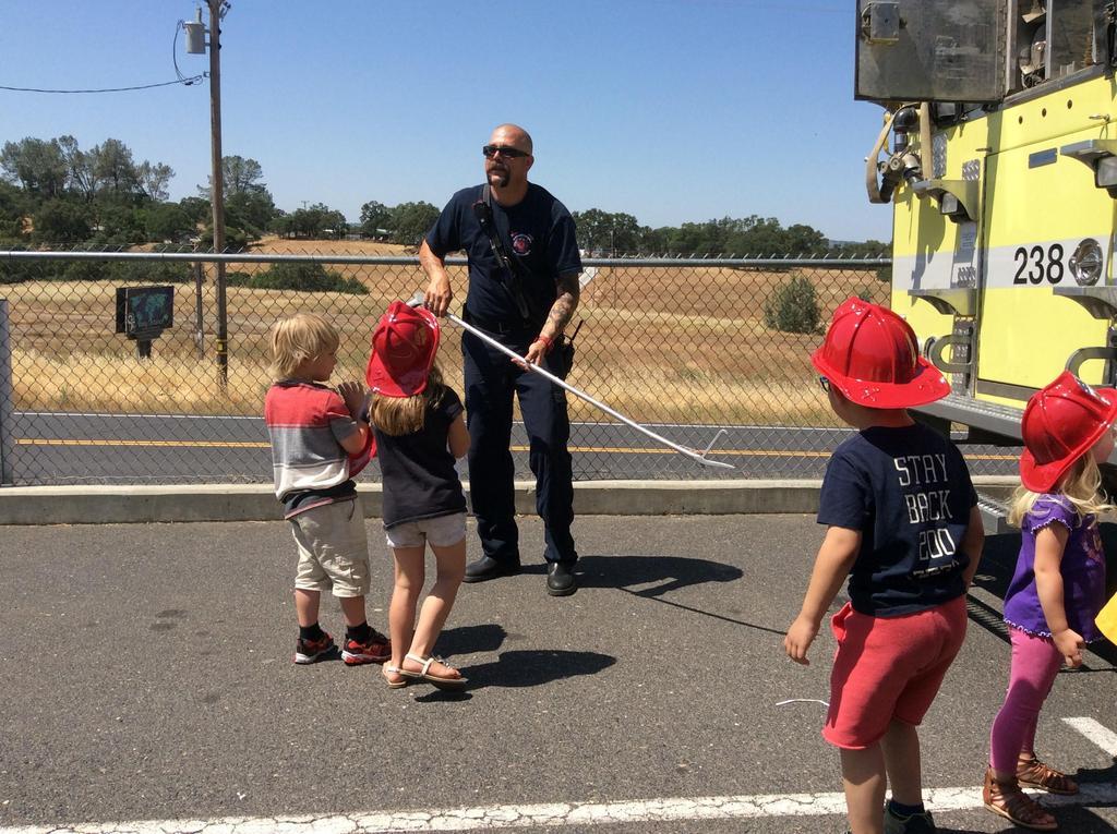 children and a fireman