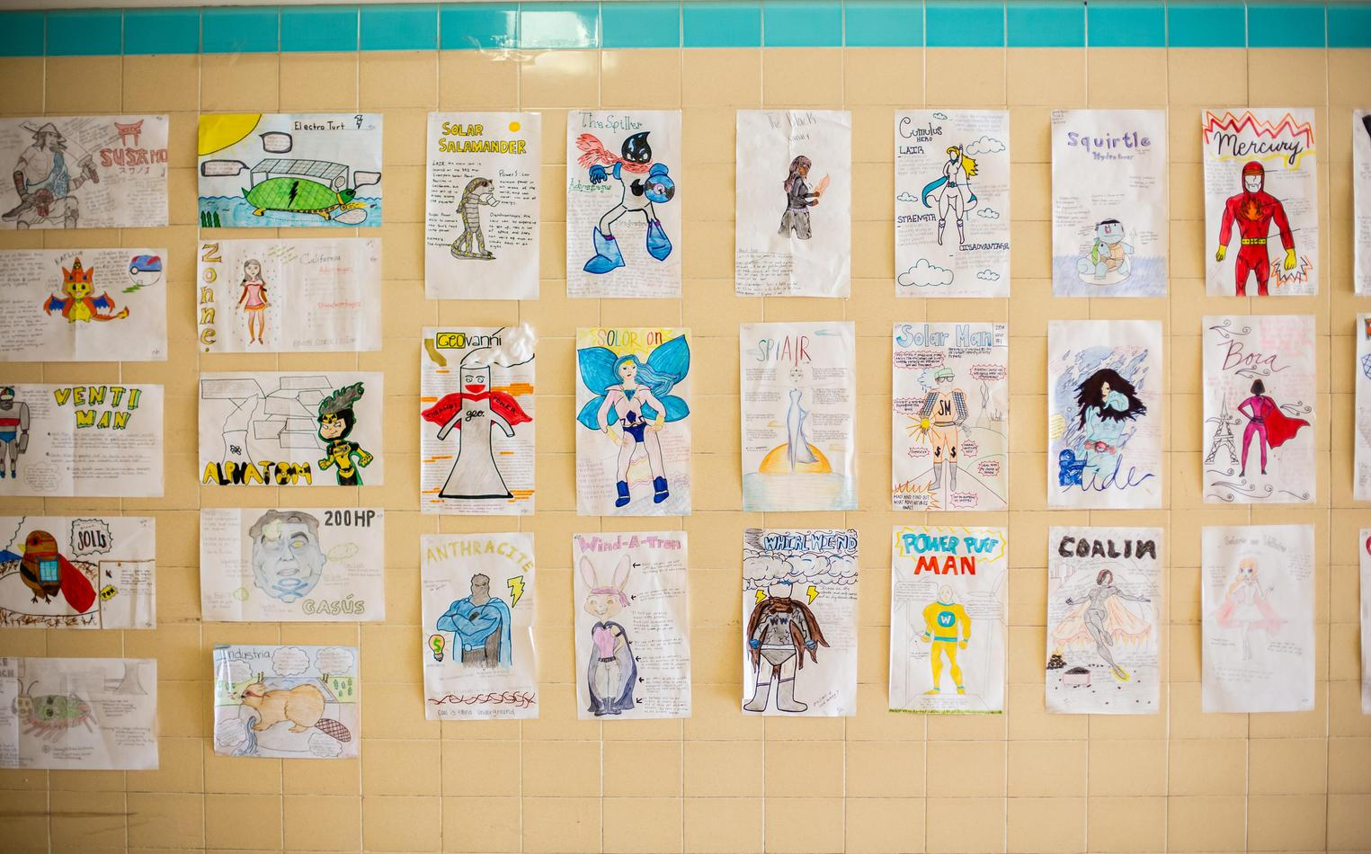 Student artwork displayed in school hallway.