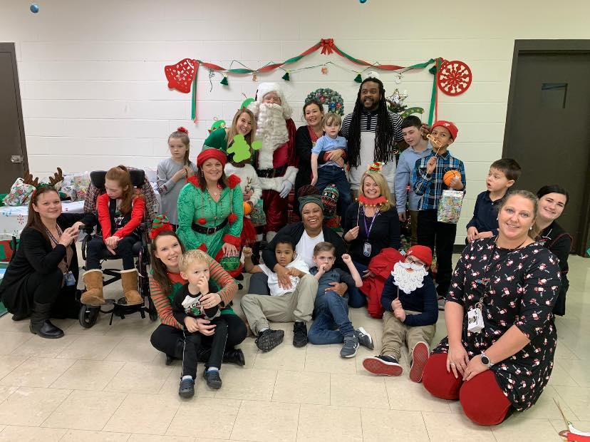 children and adults with santa