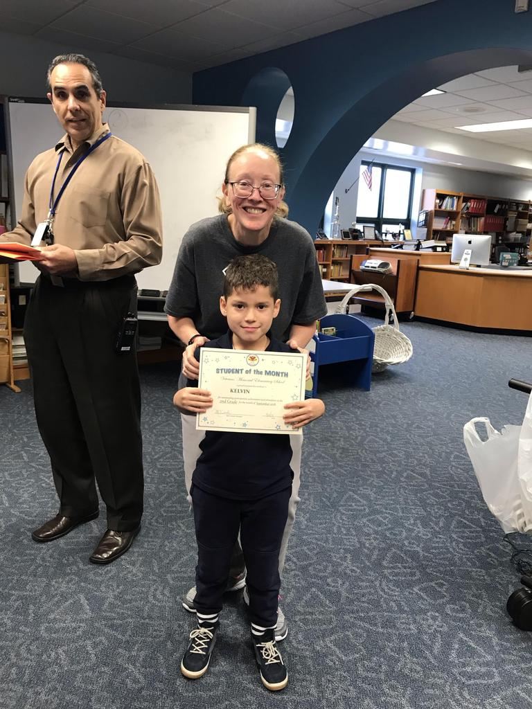 student of the month Kelvin grade 2 with principal O'connel