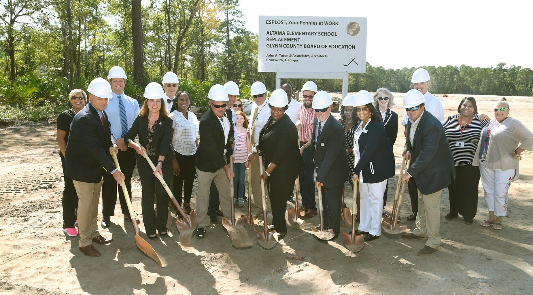 GCSS Board members turn over dirt on new AES.