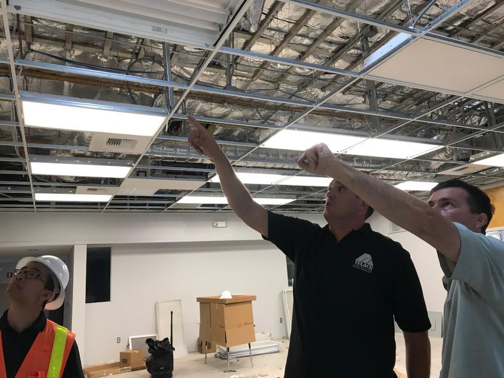 Mr Harrison supervises renovation