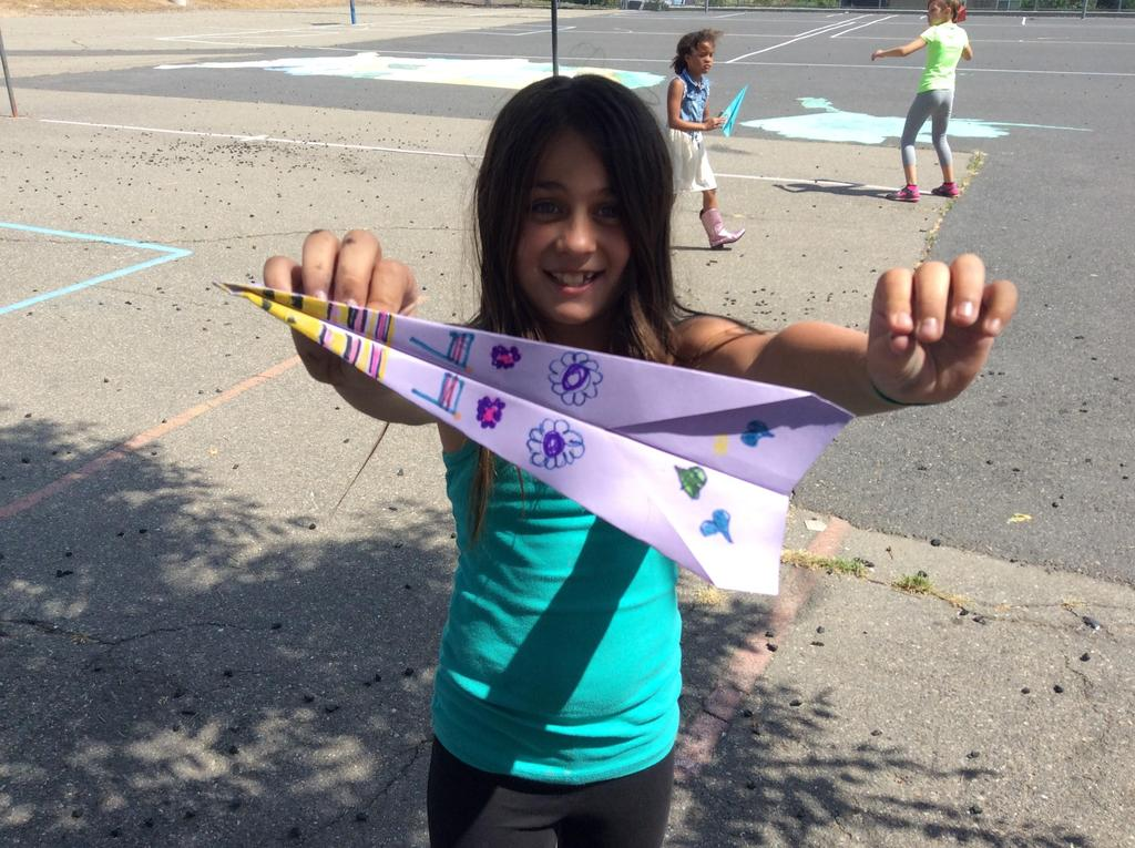 children and paper airplanes
