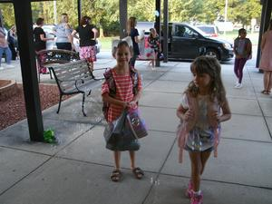 Students walk through bubbles as they enter the front doors.