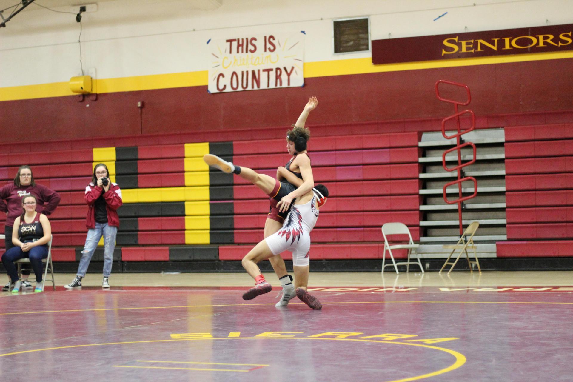 Chowchilla high wrestlers in action
