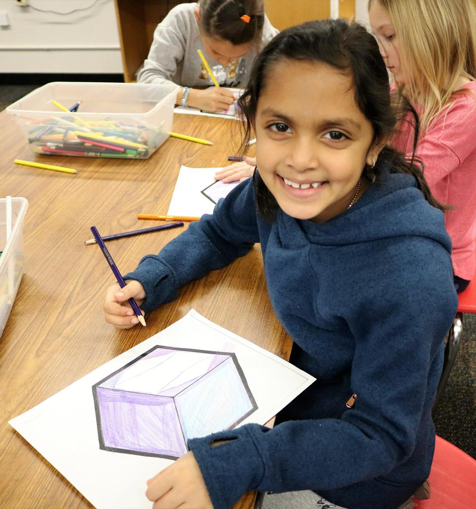 Photo of Tamaques 2nd grader working on collaborative street art project on STEAM Day.