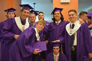 A group of boys from the OLSH class of 2018 pose together on graduation day