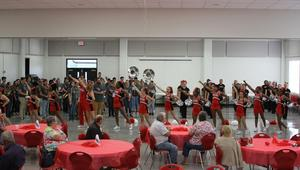 Cheerleaders, drill team and band perform for Golden Trojans