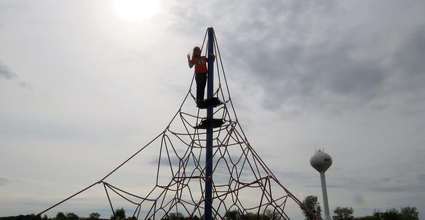 One Page student is all alone at the top of the Page climbing structure.