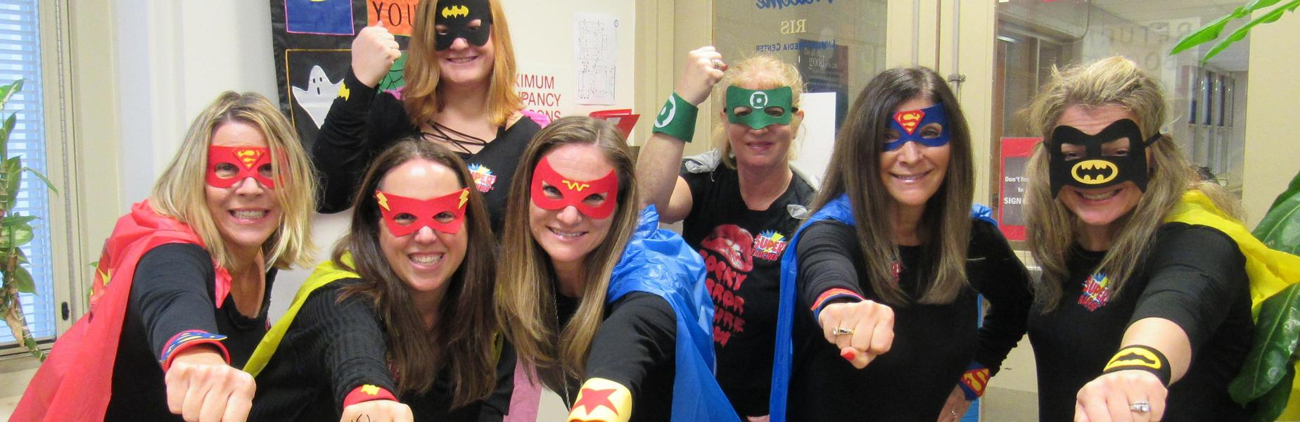 Photo of RIS staffers dressed as superheros for Halloween.
