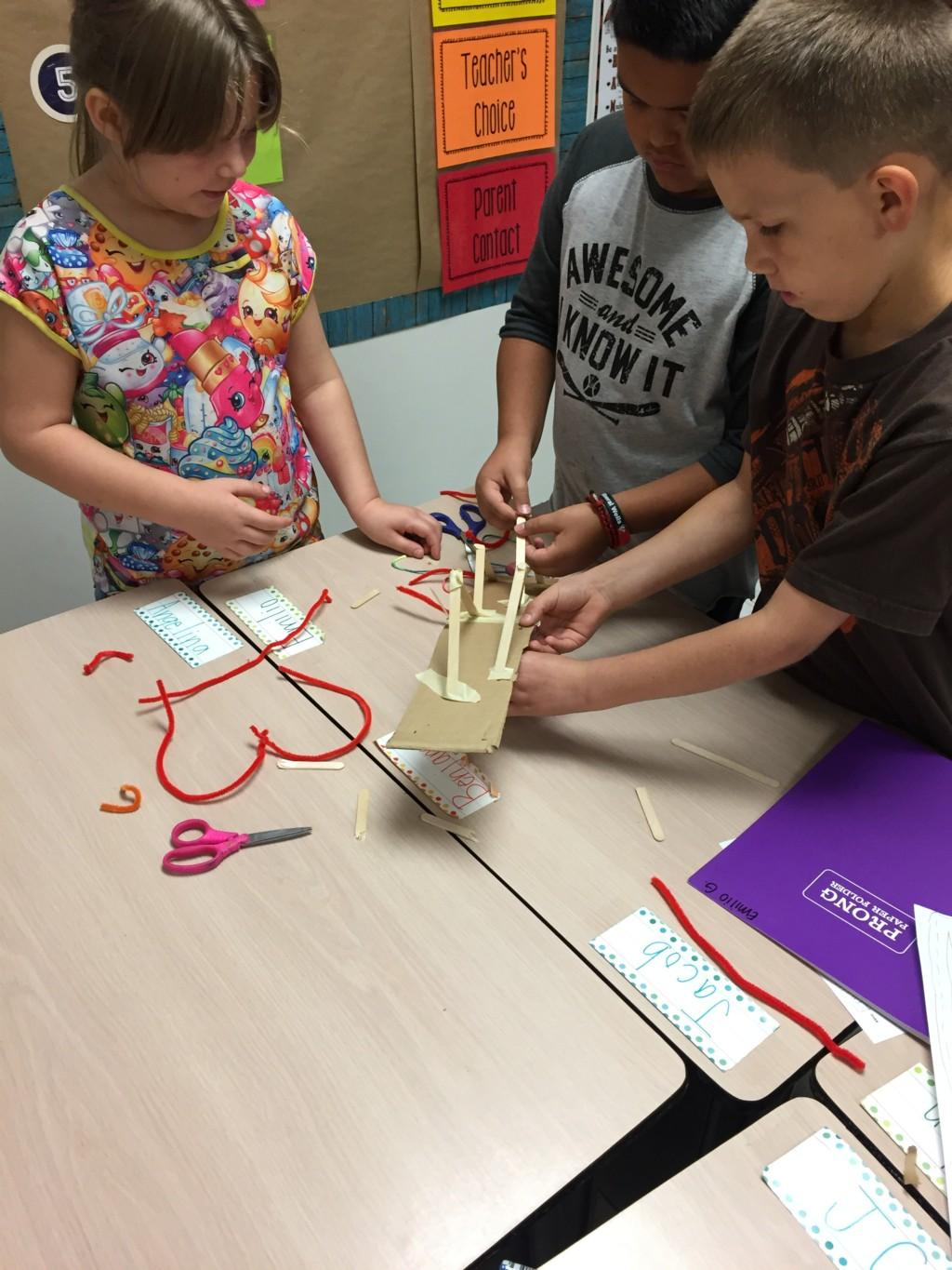 Students worked as a team combining different types of matter together to create bridges or towers.