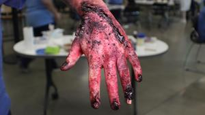 Moulage (fake injuries for training) of a badly injured hand.