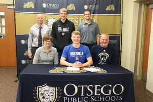 Woodhams with his family, coach and athletic director.