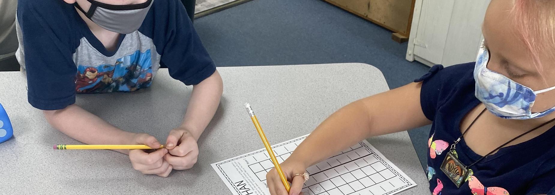 1st grade students performing math activity