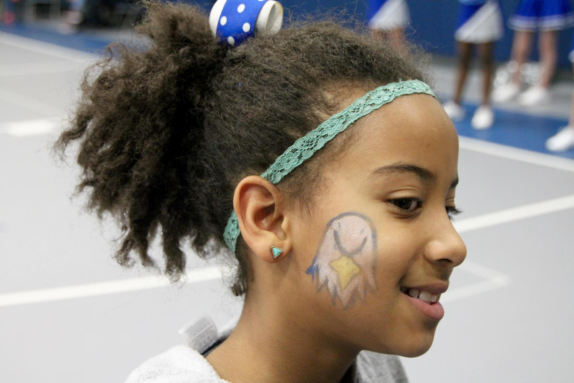 Student with MCS logo face painting