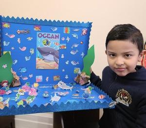 Boy with his ocean project