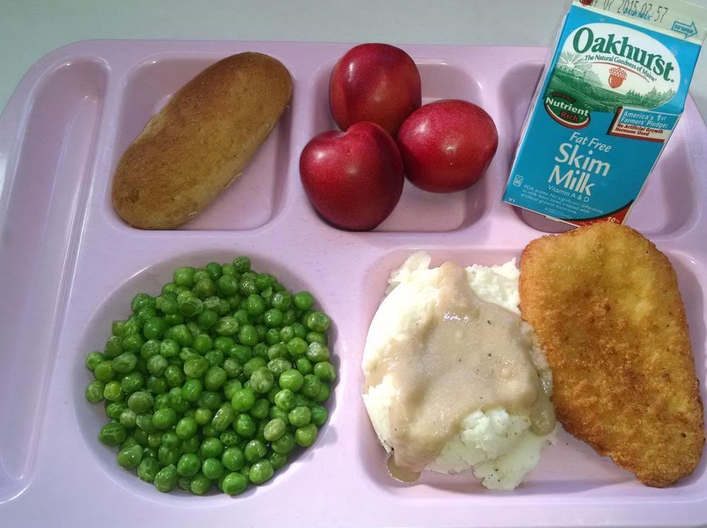 Chicken Breast Patty, Mashed Potatoes & Gravy, Garden Peas, Whole Wheat Breadstick, Plums and Milk