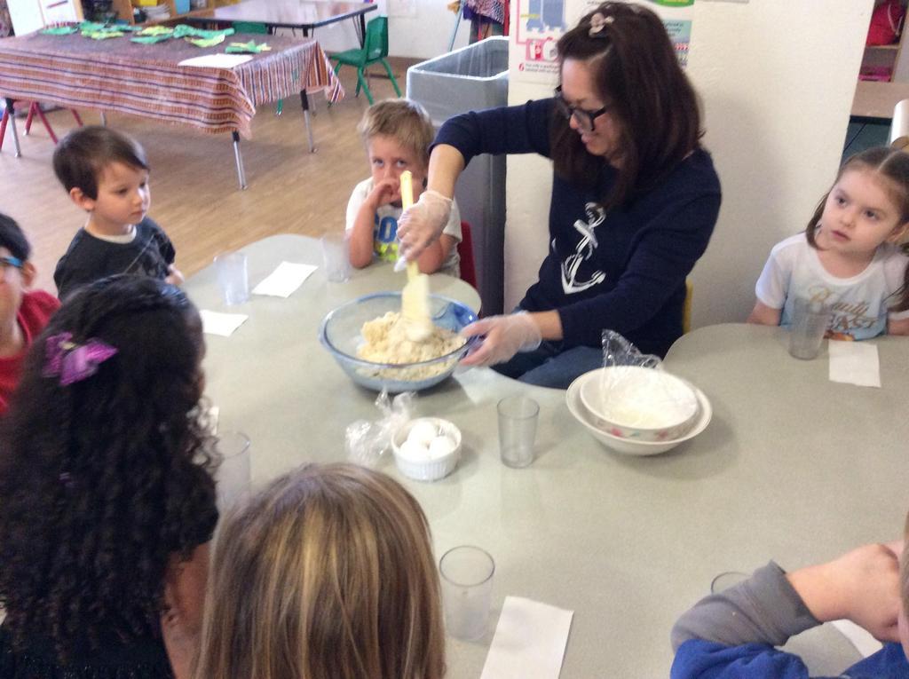 teacher and children making food