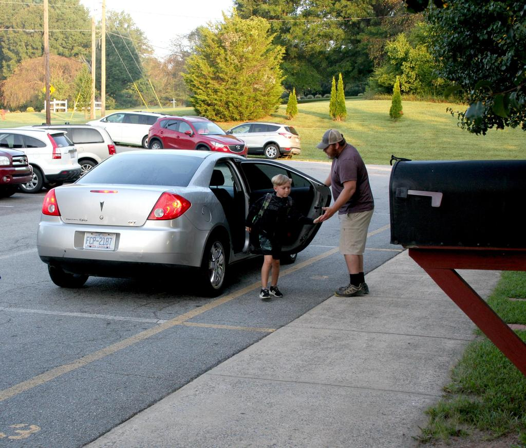 Student is greeted in car line on the first day of school at C.B. Eller Elementary.