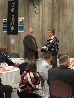 TK Board of Education member Dave Smith receives the President's Award of Recognition from the Michigan Association of School Boards.