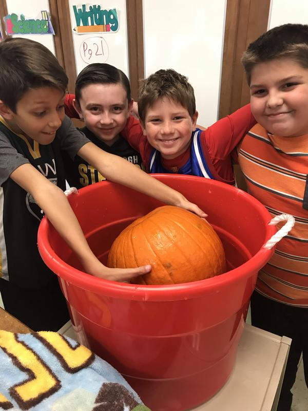 Picture of kids with pumpkin
