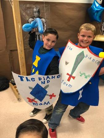 Students Showing off their shields at Mother/Son Date Knight