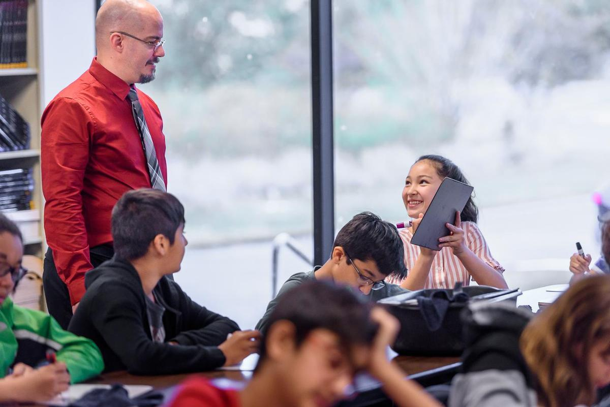 Middle School Student Smiling at Teacher