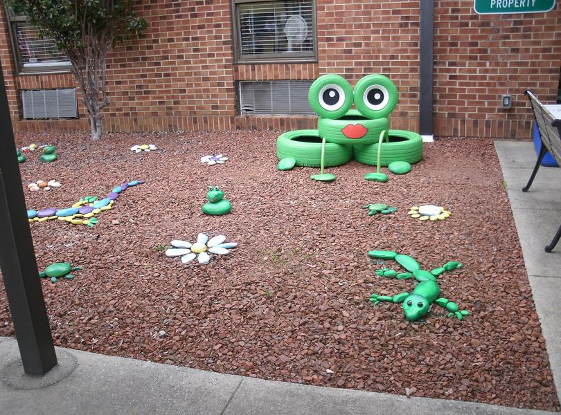 Frog art in front of our school.