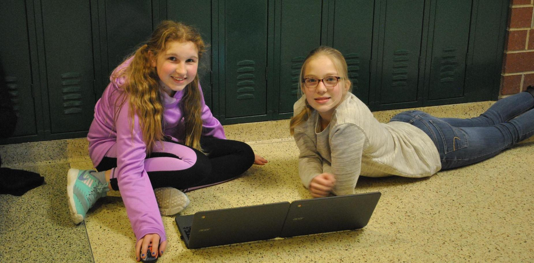 girls working on Chromebooks