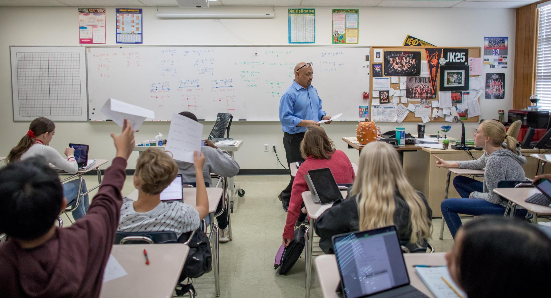 teacher up front of classroom