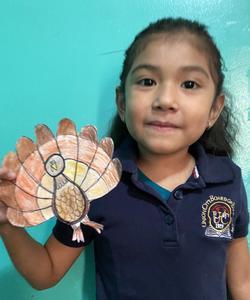 Student in uniform holding turkey