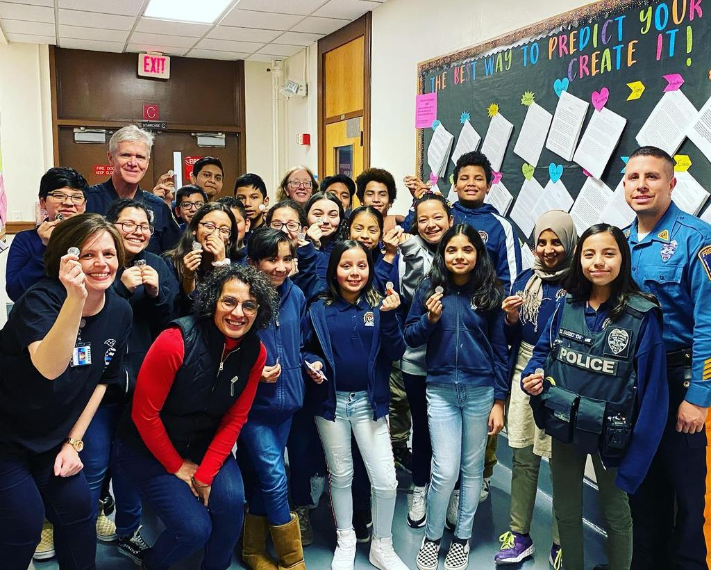 Ms. Cerullo's class with officer Vasquez vet Lucy and principal O'Connell