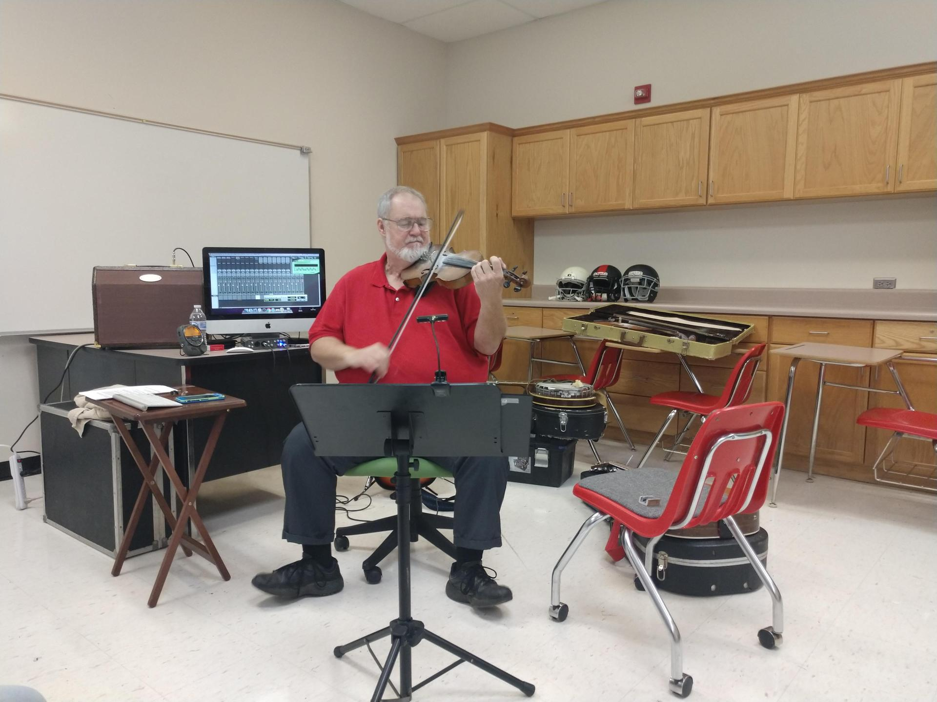 Musician performs on Career Day.