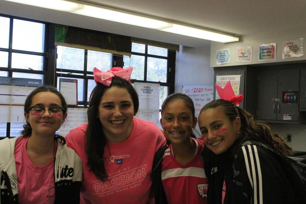 Mrs. Doyle and 8th grade students wear pink
