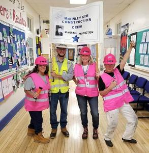 Photo of McKinley principal Marc Biunno and his staff, dressed as a construction crew, for Halloween.