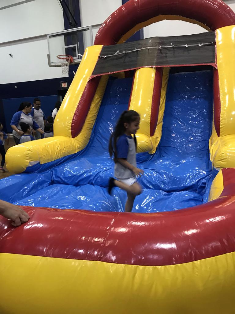 girls jumping out of bouncy house