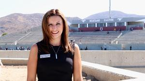 Shannyn Cahoon standing in front of the Mustang Stadium