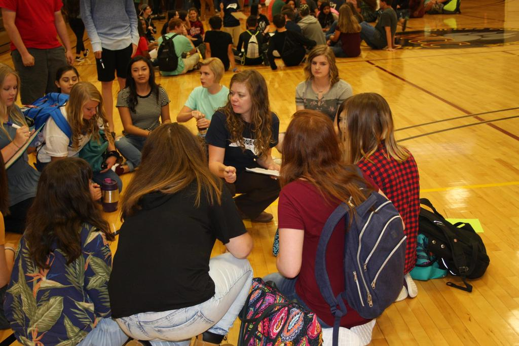 Teacher and students engage in team building activities on the first day of school at WECHS