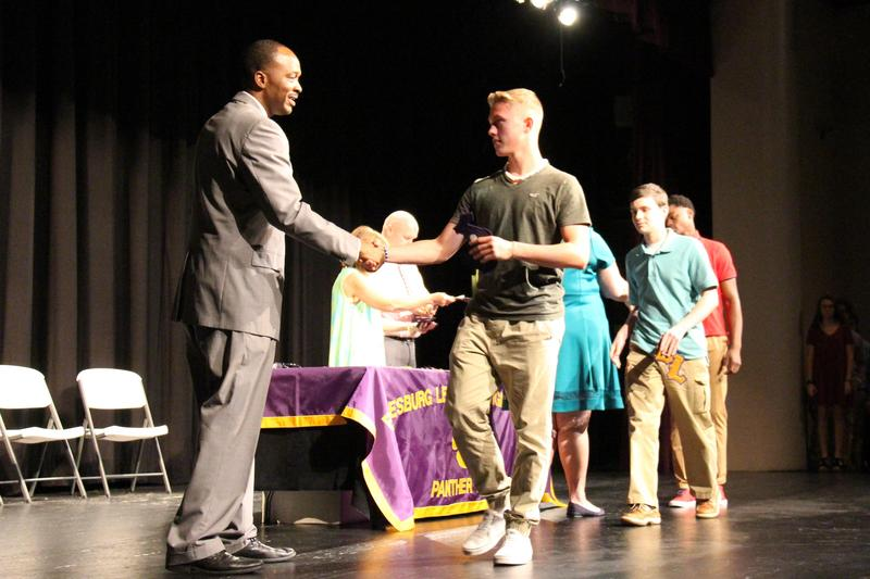 Dr. Randall Gary, Superintendent of Lexington County School District Three, presents an academic letter to B-L High School freshman Caden Ricciardi during the Academic Letter Ceremony on May 2nd.