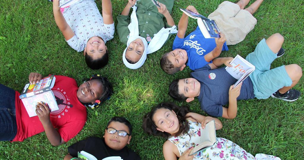 kids laying on grass