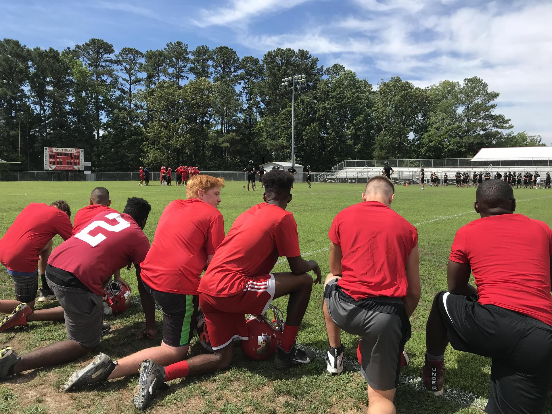 NEHS Football Players during a summer scrimmage game.