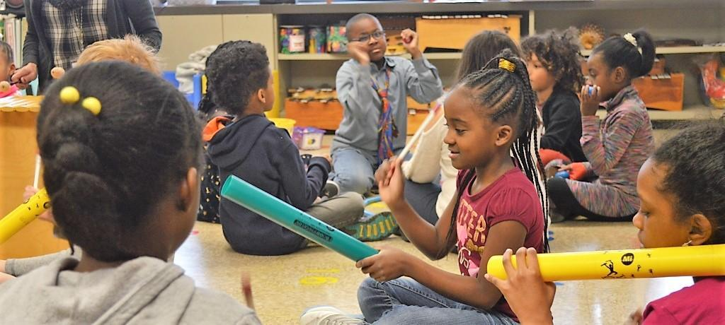 playing percussion instruments in music class