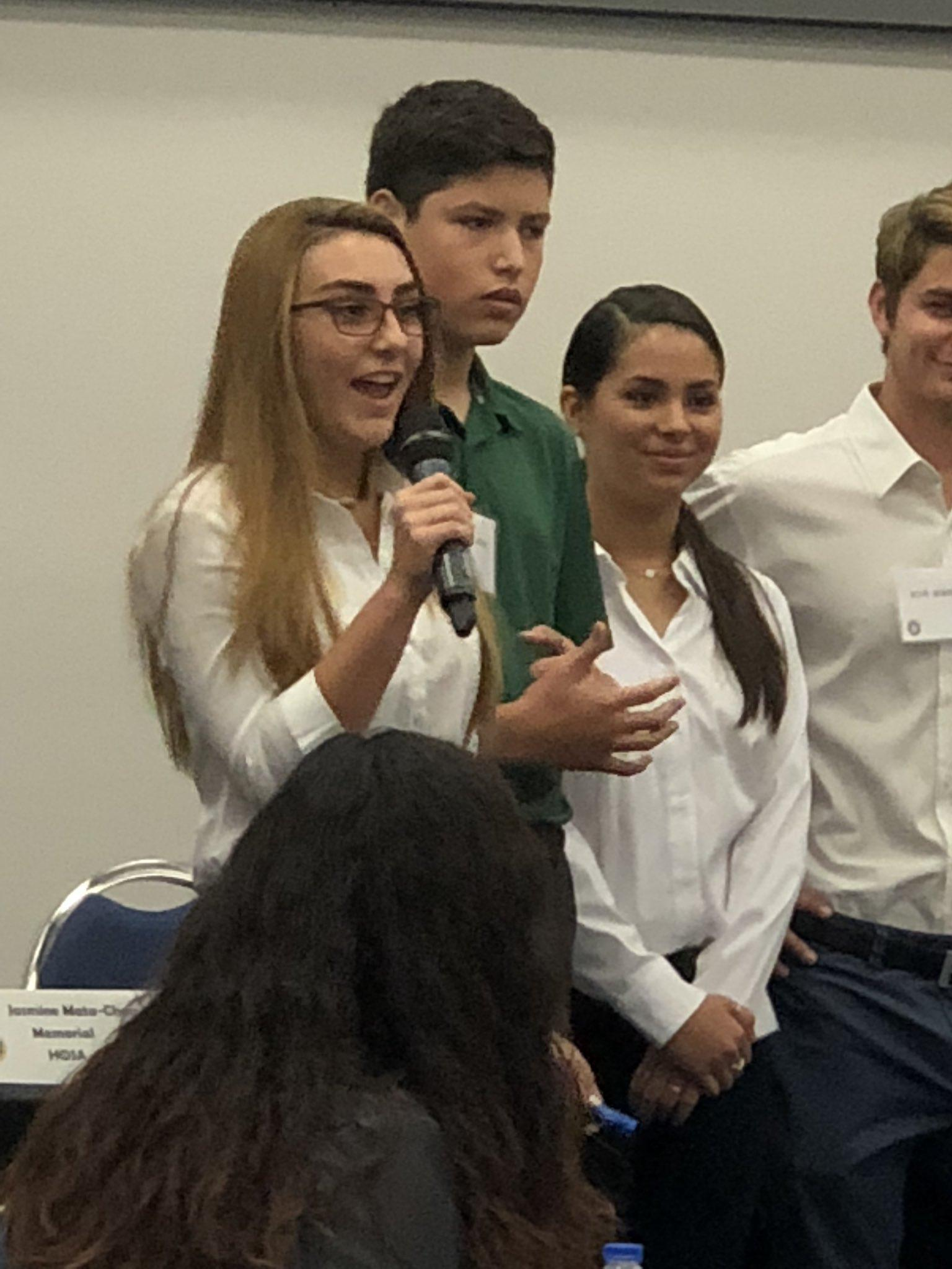 students speaking with a microphone