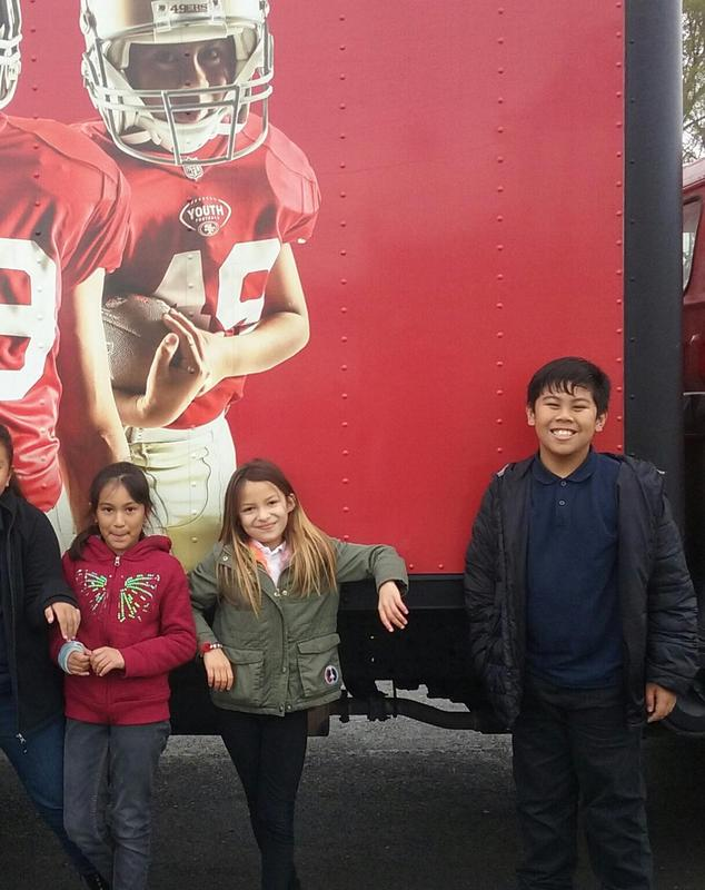 Students in front of 49ners truck.