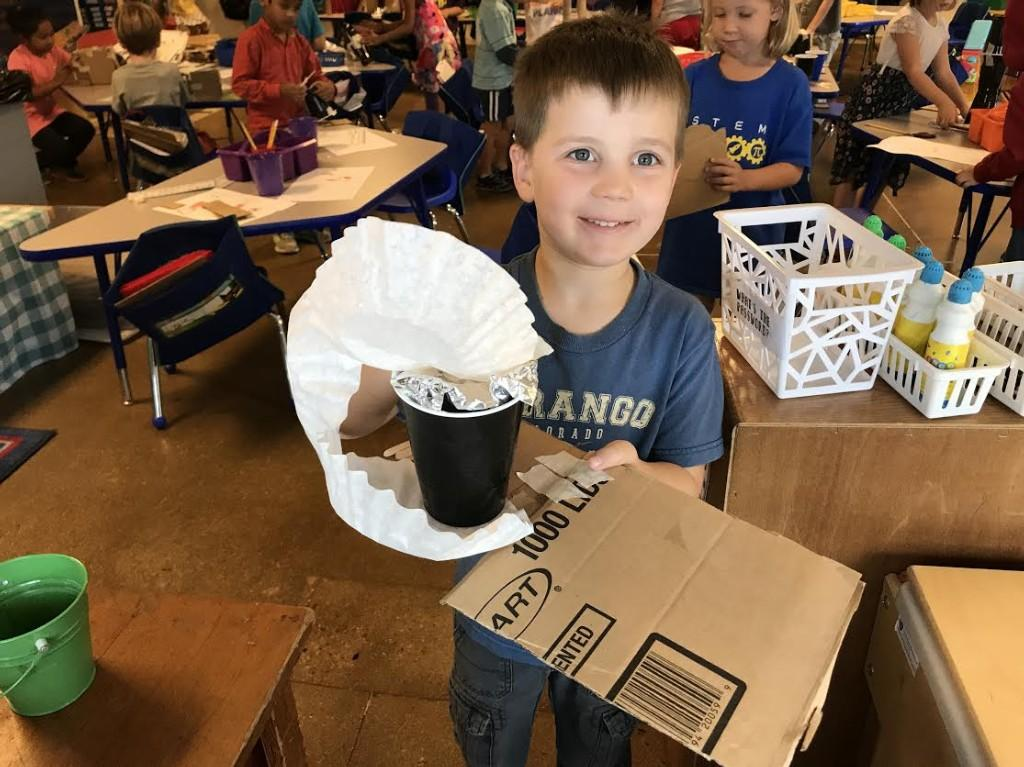 Kindergarteners with their shade structures.